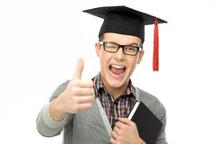 Graduate showing thumbs up Royalty Free Stock Photos