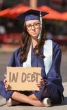 Graduate Sitting with Debt Stock Photos