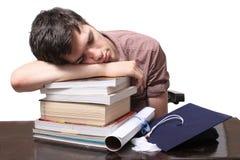 Graduate sleeping on books Royalty Free Stock Images