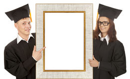 Graduate standing behind frame Royalty Free Stock Photography