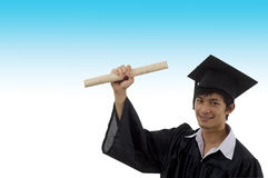 Graduate student with arm raised Royalty Free Stock Photo