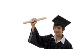 Graduate student with arm raised Royalty Free Stock Images