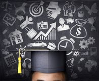 A graduate student on the background of a school board. Man`s thoughts painted on a school board. 3d illustration Stock Photo