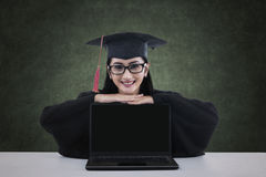 A graduate student with blank screen laptop Stock Images