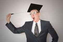 Graduate student. Graduate student in the cap isolated on gray background. Education concept royalty free stock photo