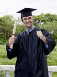 Graduate student excited about his success Stock Photos