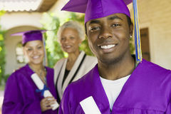 Graduate Student With Family In Background On Convocation Day Stock Images