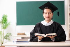 The graduate student in front of green board royalty free stock photo