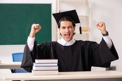 The graduate student in front of green board royalty free stock photography