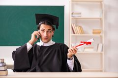 The graduate student in front of green board. Graduate student in front of green board royalty free stock image