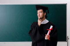 The graduate student in front of green board. Graduate student in front of green board stock image