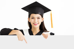 Graduate student girl showing blank placard board Royalty Free Stock Photos