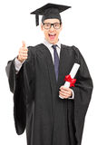 Graduate student giving a thumb up Stock Photo