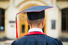Graduate student hands holding diploma from the back Royalty Free Stock Photo