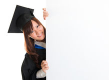 Graduate student hiding behind blank placard Royalty Free Stock Photo