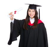 Graduate student hold diploma Royalty Free Stock Images