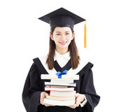 Graduate student holding  diploma and books Stock Image