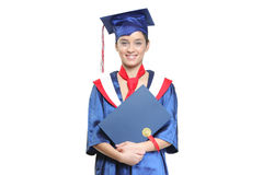 Graduate student holding her diploma Stock Photography