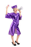Graduate student holding her diploma Royalty Free Stock Images