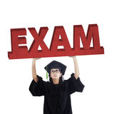 Graduate student holds an exam text Stock Photography