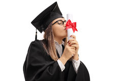 Graduate student kissing a diploma Royalty Free Stock Images