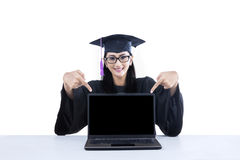 Graduate student pointing at empty screen on laptop Stock Photos