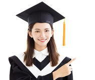 Graduate student with pointing gesture Royalty Free Stock Photos