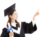 Graduate student with pointing gesture Royalty Free Stock Image