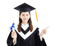 Graduate student with pointing gesture Royalty Free Stock Photography