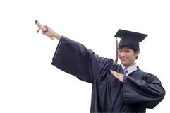 Graduate student pointing to the sky Royalty Free Stock Photos