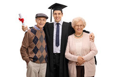 Graduate student posing together with his grandparents. Isolated on white background Stock Photo