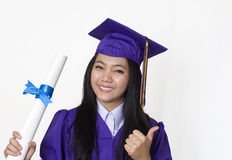 Graduate student  proudly holding her diploma Stock Photography