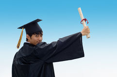 Graduate student with raised arm Royalty Free Stock Photos