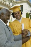Graduate Student Receiving Gift From Father Stock Images
