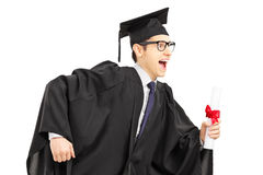 Graduate student running and holding a diploma. Isolated on white background Stock Photography