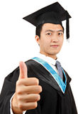 Graduate student with thumb up Royalty Free Stock Images