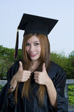 Graduate student with thumbs up sign Royalty Free Stock Image