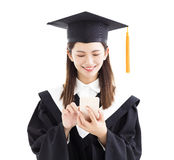 Graduate student using smart phone Stock Images