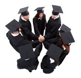 Graduate students stacking hands Stock Photos