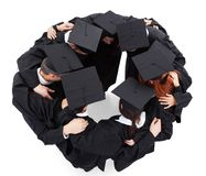 Graduate students standing in circle Royalty Free Stock Photo