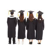 Graduate students standing a row. isolated on a white Stock Photo