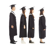 Graduate students standing a row.isolated on white Royalty Free Stock Image