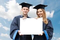 Graduate students with white board stock photo