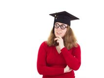 Graduate thinking about her studies Royalty Free Stock Images