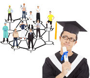 Graduate thinking about his career planning. Over white Royalty Free Stock Images