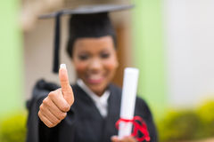 Graduate thumb up Royalty Free Stock Photography