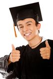 Graduate with thumbs up Stock Photography