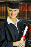 Graduate university library. Happy female law school graduate in university library royalty free stock photography