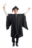 Graduate university student cheering. Full body excited Asian male university student in graduation gown arms raised, isolated on white background. Good looking Royalty Free Stock Photo