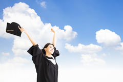 Graduate woman  with cloud background Royalty Free Stock Photo